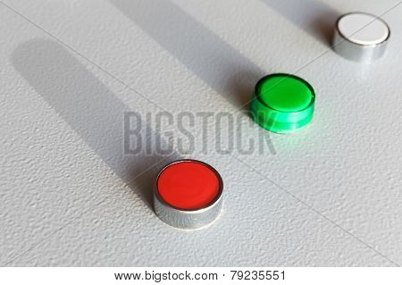 Three Industrial Buttons On Gray Control Panel