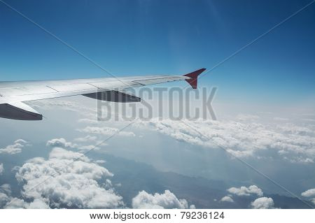 Airplane Wing And Beautiful Clouds