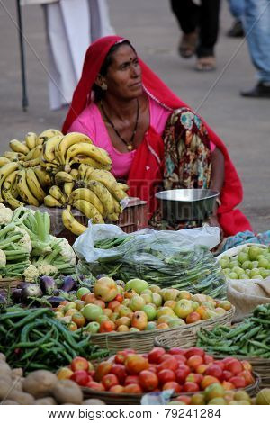 Indian woman selling vegetables and fruits