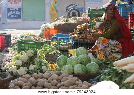 Indian Woman Selling Fruit And Vegetables On The Street