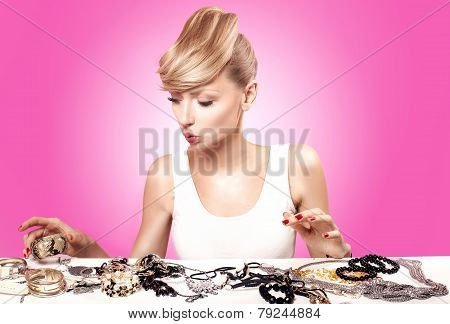Blonde Young Woman Choosing Jewelry.