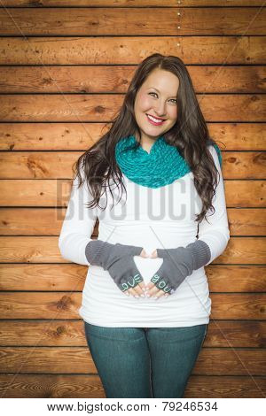 Beautiful Young Pregnant Woman Holds Her Stomach with Love You Mittens.
