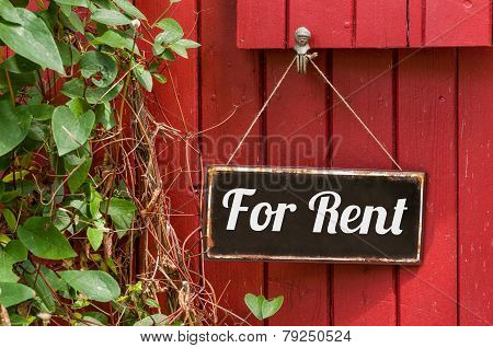 Old metal sign with the inscription For Rent