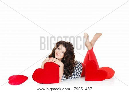 Beautiful brunette lying on the floor, cross-legged like the tail of a fish, with a red heart in han