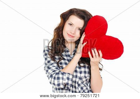 Attractive woman with red heart-shaped pillow isolated on white background.