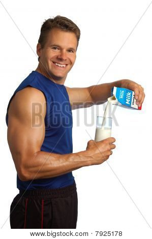 Fitness Man Pours Milk