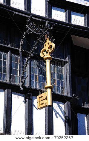Gold Key on Tudor building.