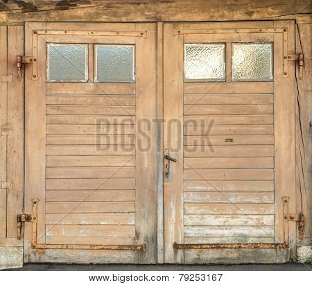Old garage door with four small windows