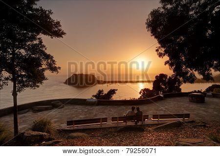 Lovers Enjoy The Sunrise Over Pittwater Palm Beach