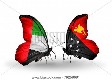 Two Butterflies With Flags On Wings As Symbol Of Relations Uae And  Papua New Guinea