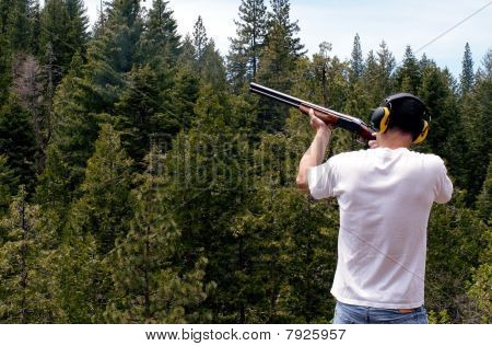 Man shooting clay pigeon