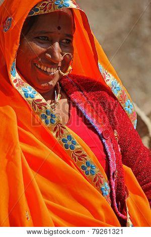 Indian Woman With An Orange Vivid Veil