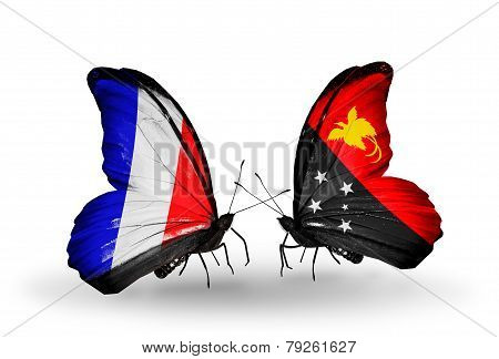 Two Butterflies With Flags On Wings As Symbol Of Relations France And Papua New Guinea