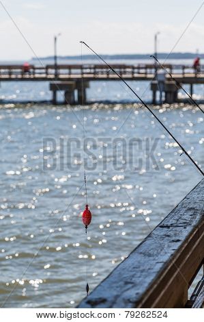Fishing Pole Off Wood Pier