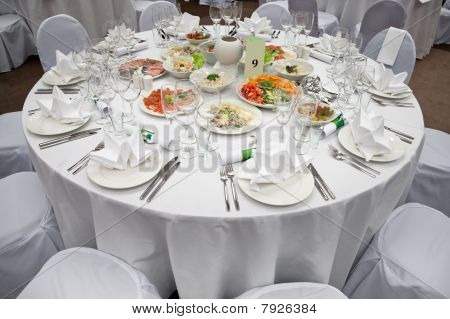Wedding White Reception Place Ready For Guests. Elegant Banquet Tables Prepared For A Conference Or
