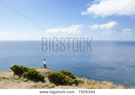 Young Man Looking At Sea