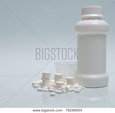White Tablets, White Container For Mixture And Measuring Cup
