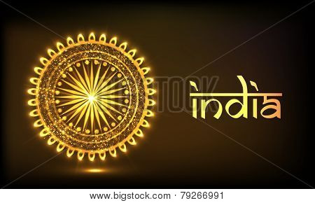 Indian Republic Day celebration with floral decorated golden Ashoka Wheel and stylish text India on brown background.