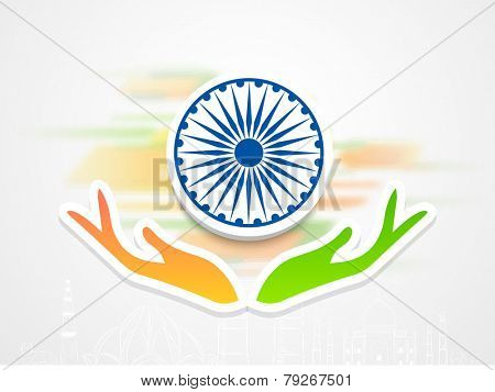 3D Ashoka Wheel protecting by human hand in saffron and green color for Indian Republic Day celebration on famous monuments background.