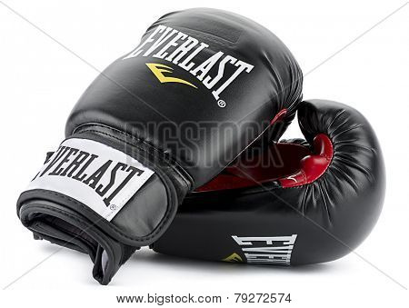 Ankara, Turkey - November 25, 2014:  A pair of black Everlast boxing gloves isolated on white background.