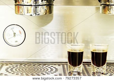 Two Espresso Shots On Coffee Machine Background