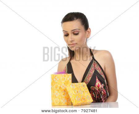 Teenage girl seeing gift box