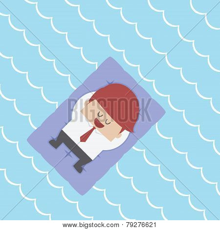 Relaxed Businessman Floating On Pool Raft
