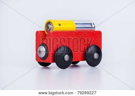 AA alkaline battery on a wood wagon