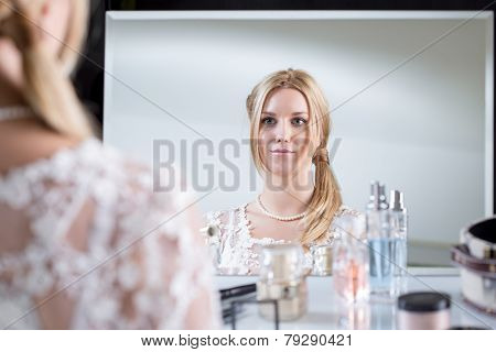 Bride Looking At The Mirror