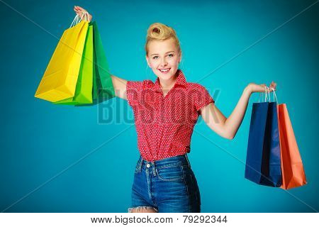 Pinup Girl With Shopping Bags Buying Clothes. Sale