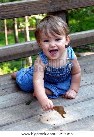 Cute Kid in Blue Overalls