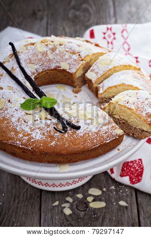 Vanilla, chocolate and almond cake on a stand