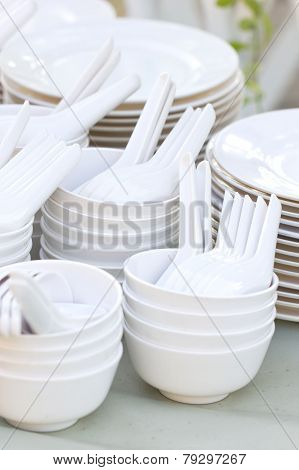 Many White Bowls, Spoons And Dishes.