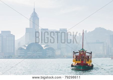 Hong Kong Skyline With Boats In Victoria Harbor.