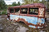 picture of junk-yard  - rusty bus on junk yard near Illinci village in Chernobyl Nuclear Power Plant Zone of Alienation Ukraine - JPG