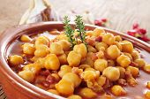 picture of stew  - closeup of an earthenware bowl with potaje de garbanzos con jamon - JPG
