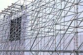 stock photo of scaffold  - Background of the construction of the aluminum tubes scaffolding - JPG