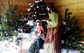 stock photo of manger  - Christmas Manger scene with figurines including Jesus - JPG
