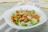 stock photo of iceberg  - Caesar salad with shrimps and iceberg leaves - JPG