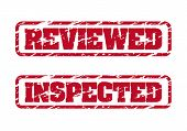 stock photo of inspection  - Reviewed and inspected rubber stamps on white background - JPG