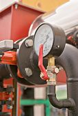 picture of vacuum pump  - Closeup of pressure meter located on a pipeline - JPG