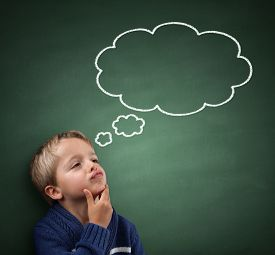 stock photo of confusing  - Child thinking with a thought bubble on the blackboard concept for confusion - JPG
