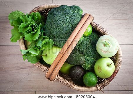 Green fruits and vegetables in basket