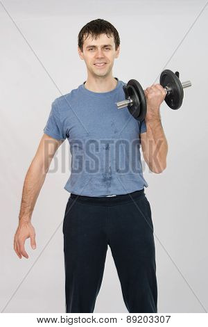 Athlete Dumbbell Raises His Left Hand
