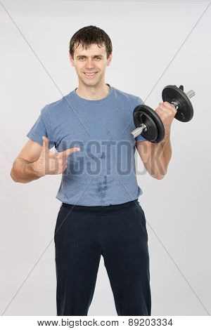 Athlete With A Positive Indicates Dumbbell