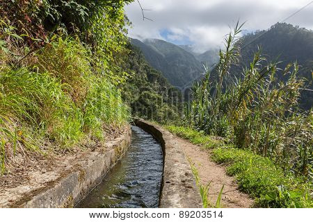 Levada, Irrigation Canal With Hiking Path At Madeira Island, Portugal