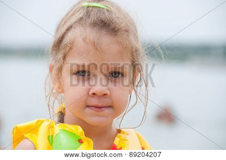 Portrait Of A Three-year Girl On The Beach
