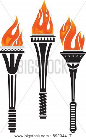 Set of three torches. Vector illustration isolated on a white.