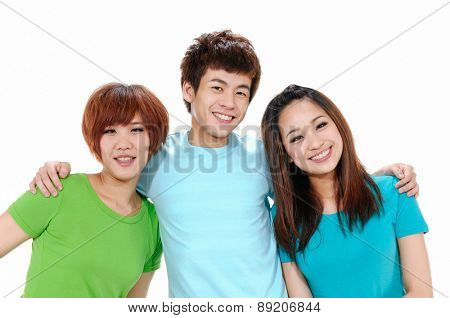 Three young happy friends. Two girls one boy smiling