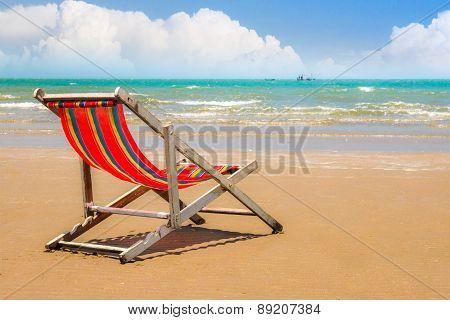 Beach Chair On The Beach With cloud and Blue Sky.